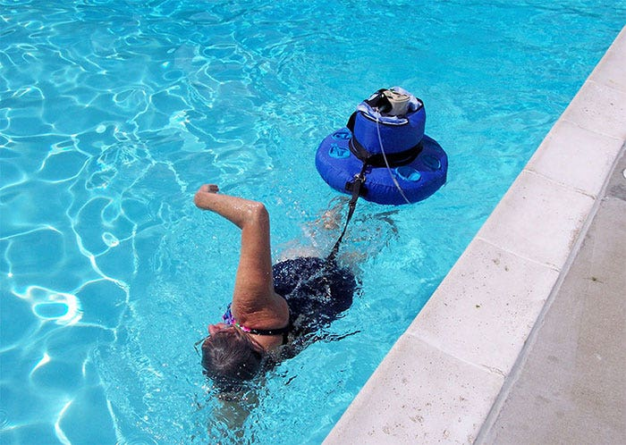 Roxlyn swimming with a High flow Liquid Oxygen Portable