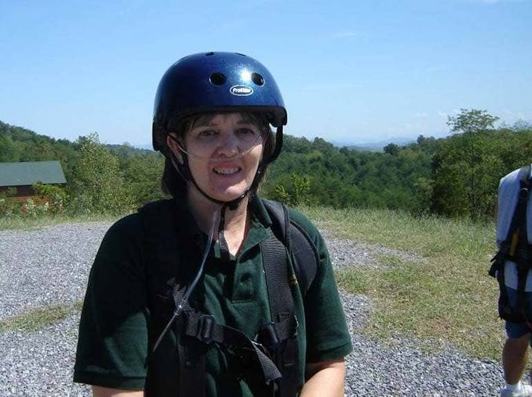 Susan before she jumped from a platform on a zip-line and soared through the trees.